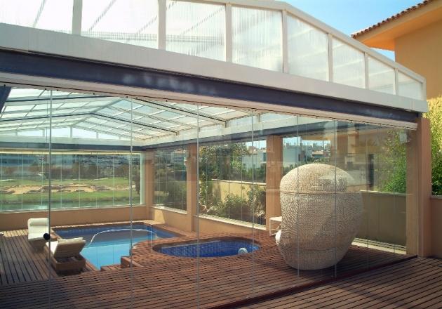Cerramientos sin perfiles para terrazas cubiertas para for Muebles para terrazas cubiertas